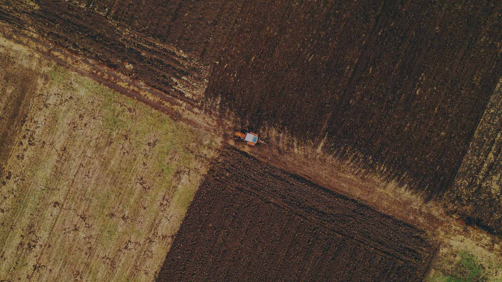 cquest-aerial-view-of-agricultural-tractor-plowing-field-1-1.jpg